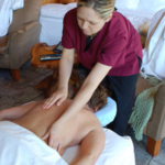 masseuse giving an in room solo massage